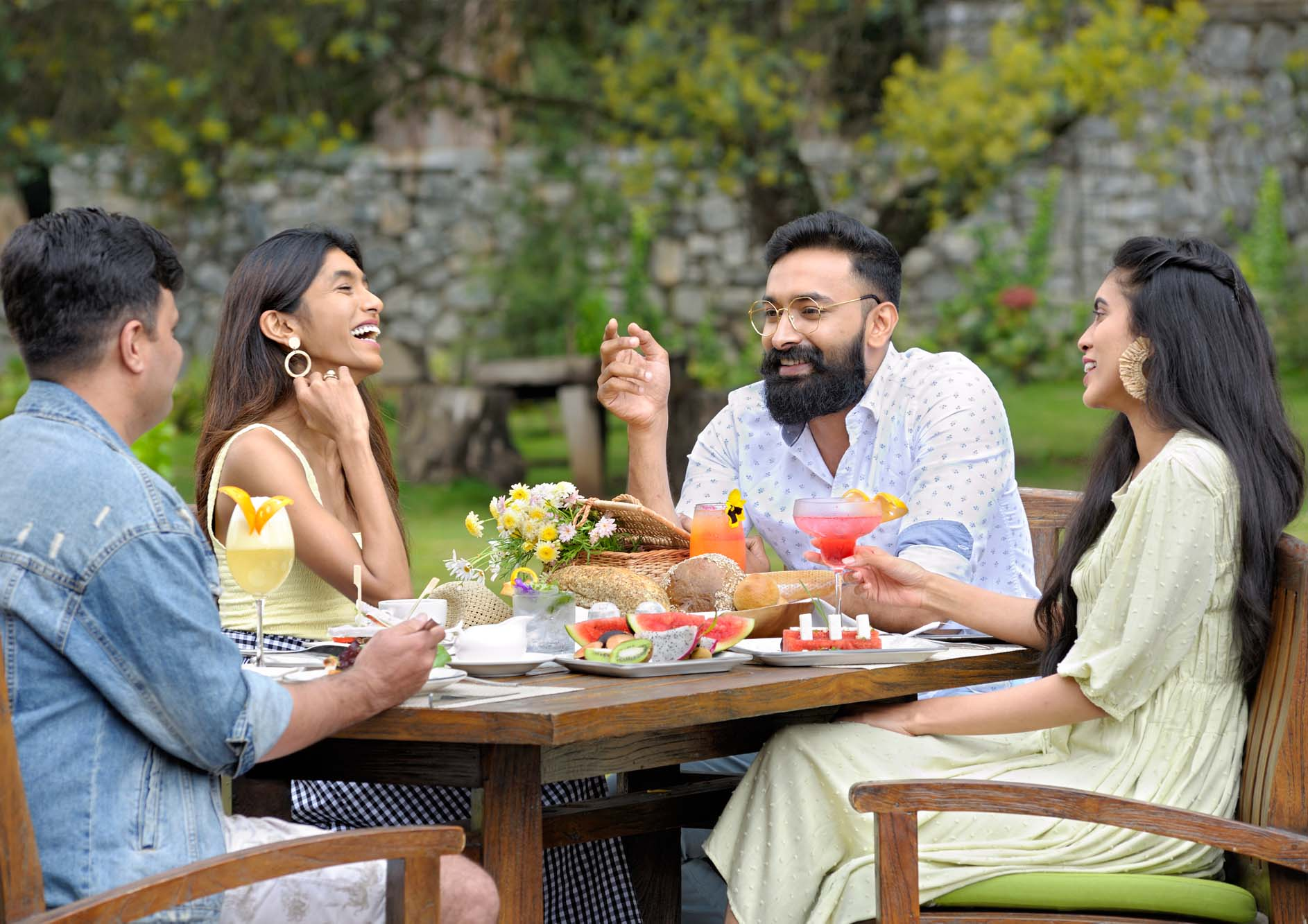 Cheerful-young-friends-enjoying-food-and-having-fun-together